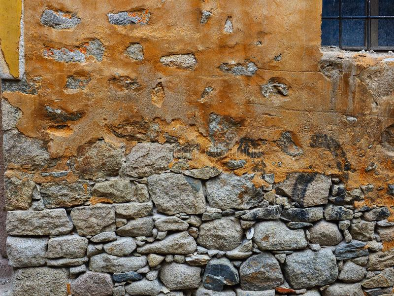 Detail of Historic rendered Dray Stone House Wall, Bulgaria. Detail of an historic dry stone house wall in Plovdiv, Bulgaria, with the brown coloured stucco or royalty free stock images