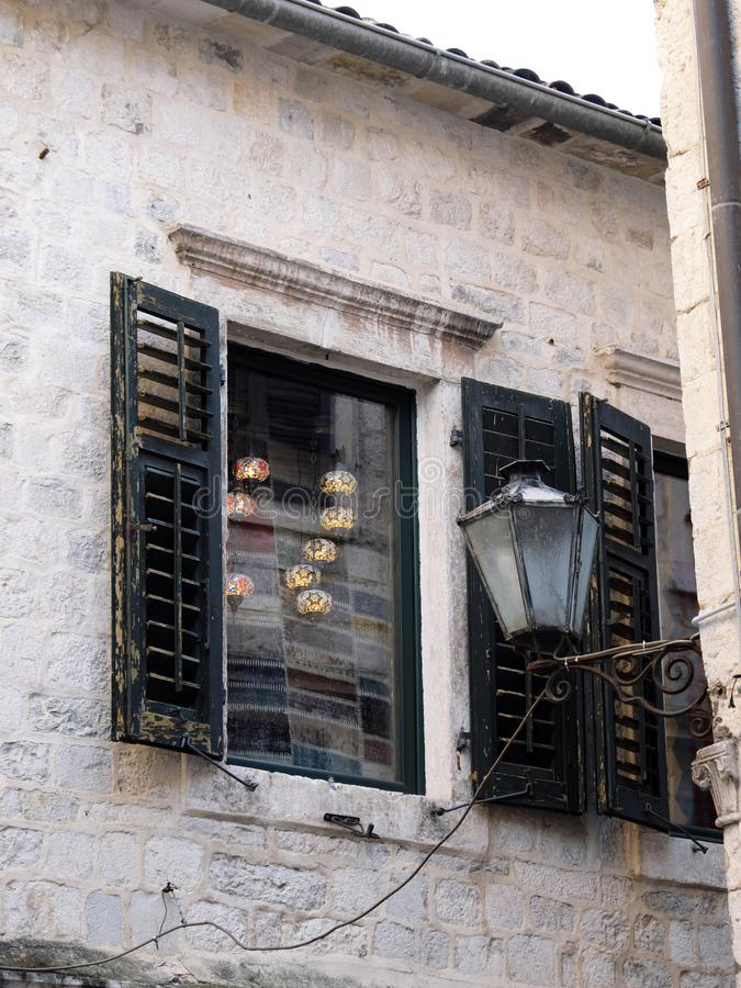 Window Shutters on Historical Stone Building, Kotor Old Town, Montenegro stock image