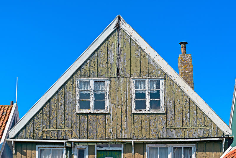 Detail of a house worn out facade in Marken stock photography