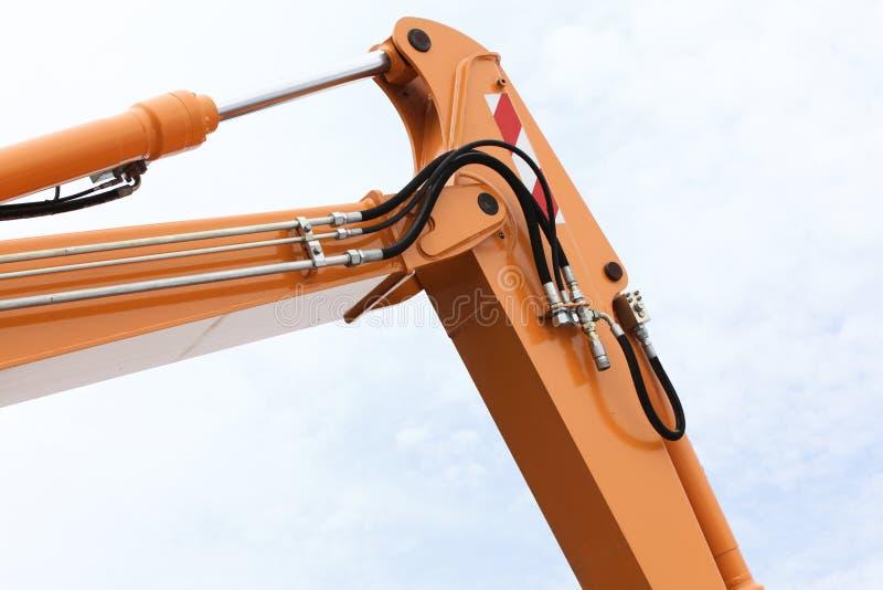 Detail of hydraulic bulldozer sky background stock photography