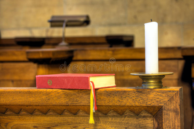 Detail of hymnal and candle royalty free stock image