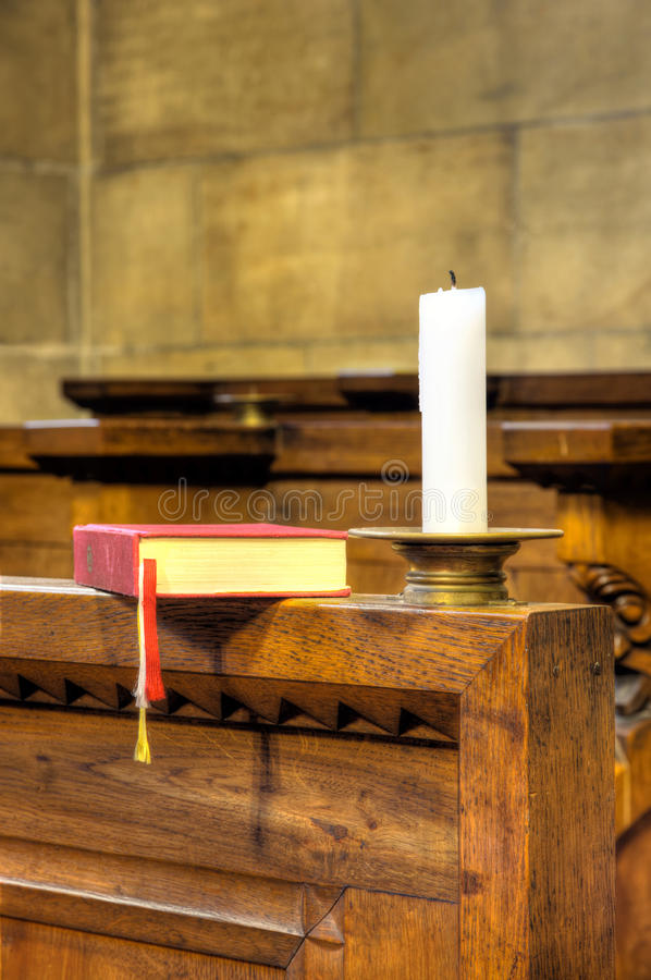 Detail of hymnal and candle stock photos