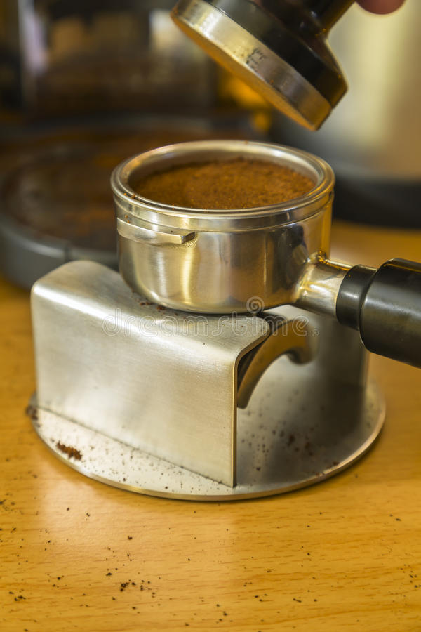 Detail image after tamping espresso grounds into a bayonet stock images