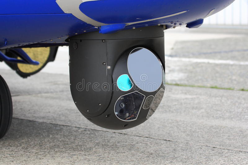Detail of infrared camera on helicopter. Rotating camera with infrared capabilities mounted on police helicopter stock image