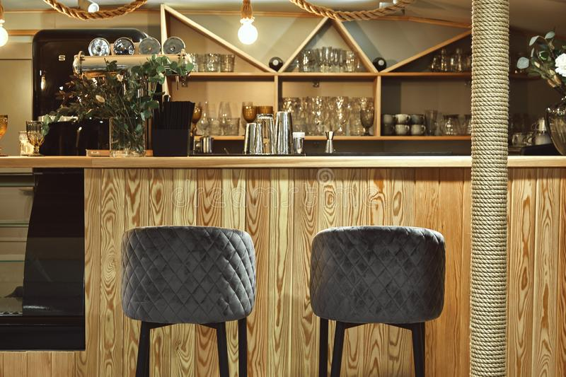Detail of interior of designed restaurant. Bar table in an expensive restaurant royalty free stock images