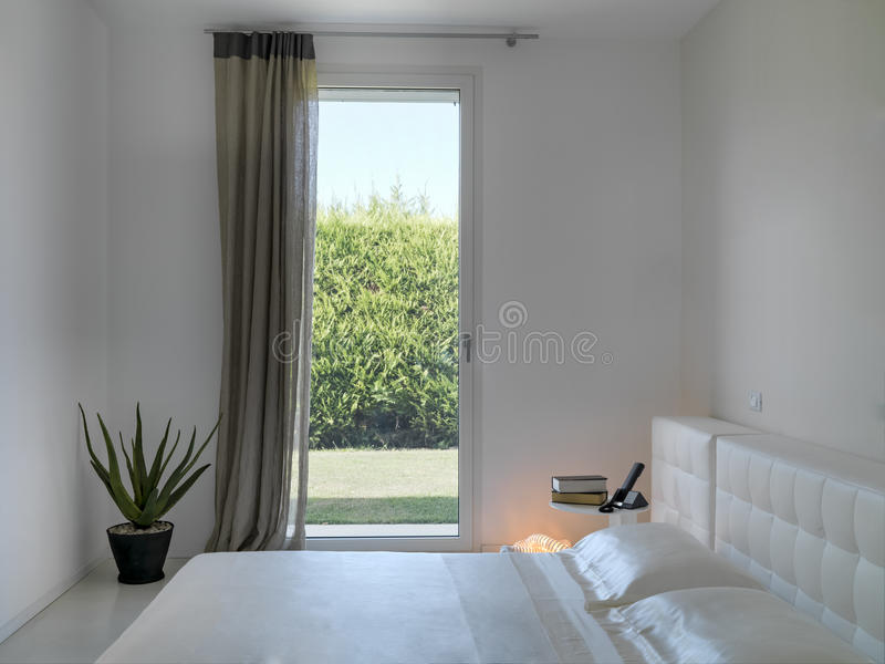 Detail of interior view of a modern bedroom stock photography