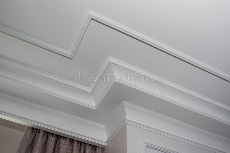 Detail of intricate corner crown molding. a detail of corner ceiling royalty free stock photos