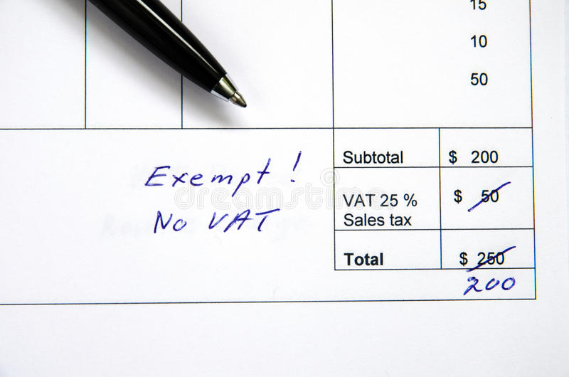 Incorrect invoice, VAT exempt. Detail from an invoice with the total amount changed because incorrect VAT, exempt royalty free stock photo