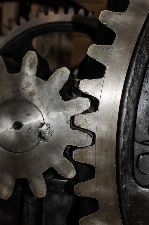 Detail of Iron Cog Wheels. Detail of two iron cog wheels with interlocked teeth royalty free stock photos