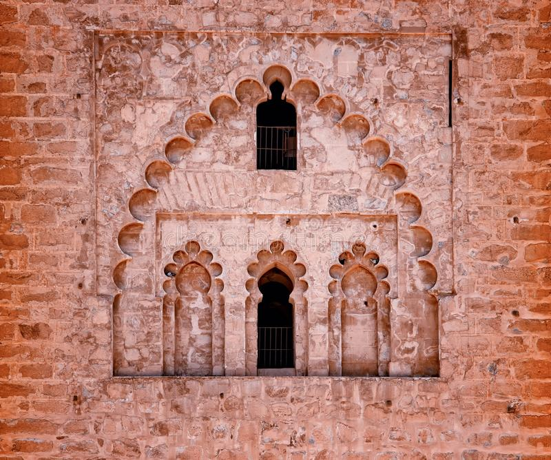 Detail of Islamic Mosque. It is an old architectural building in the middle of the Moroccan city. There are red bricks. stock image