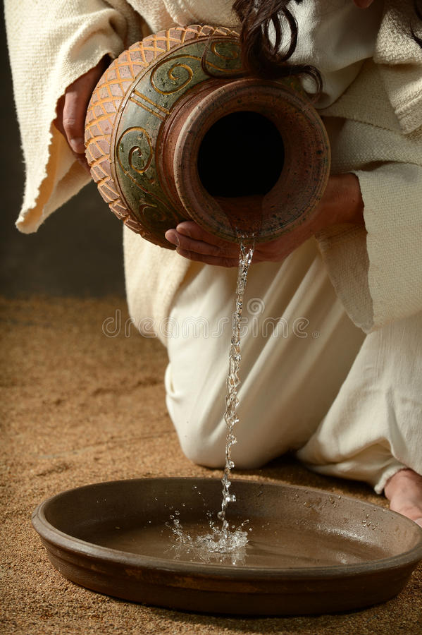 Detail of Jesus pouring water stock images