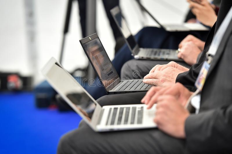 Journalists hands typing on laptops during a press conference. Detail with journalists hands typing on laptops during a press conference stock photos