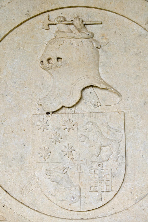 Detail of Knight in stone on wall of Templar Castle and the Convent of the Knights of Christ, founded by Gualdim Pais in 1160 AD, royalty free stock photos