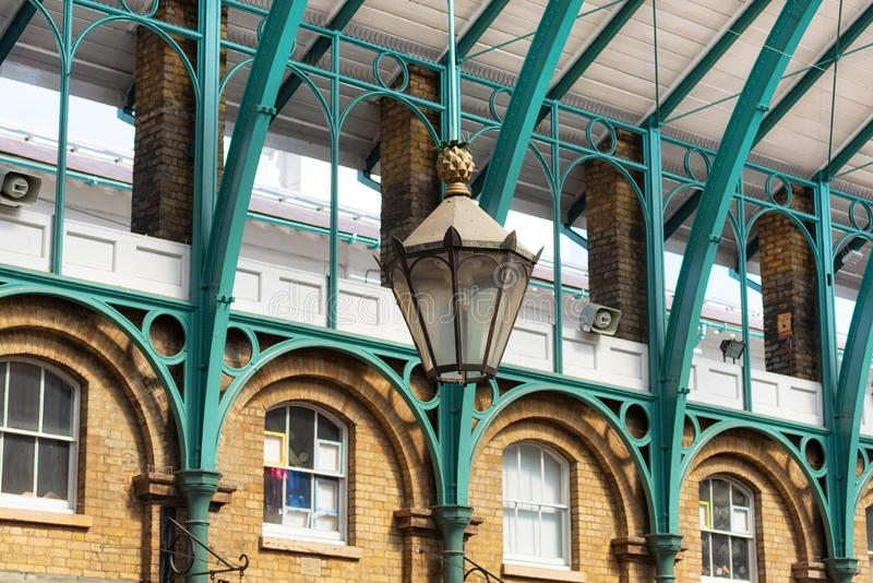 Detail of a lamp hanging from the steel roof of Covent Garden Market in London United Kingdom. royalty free stock photography