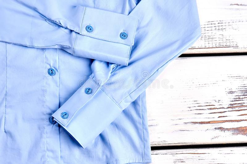 Detail of light blue cotton shirt. stock photography