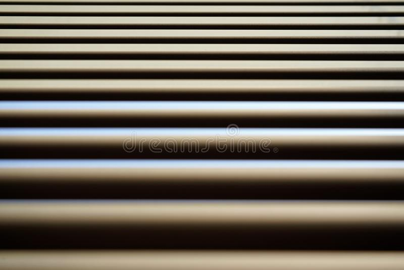 Detail on lines of metallic window blinds, some light reflects on, dust visible, abstract geometric background royalty free stock photos