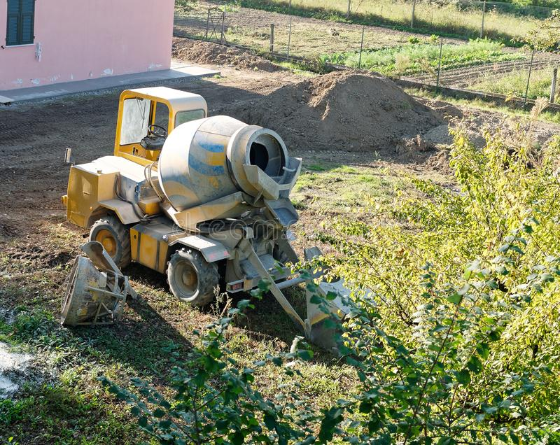 Detail of little mixer for cement. In a garden royalty free stock photography