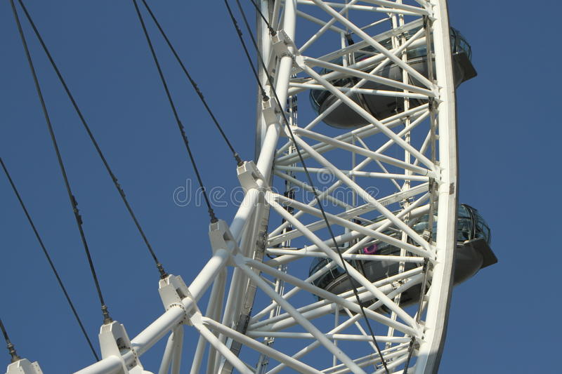 Detail of the London Eye. Close up abstract of the London Eye showing famous white wheel frame and capsule, London royalty free stock photo