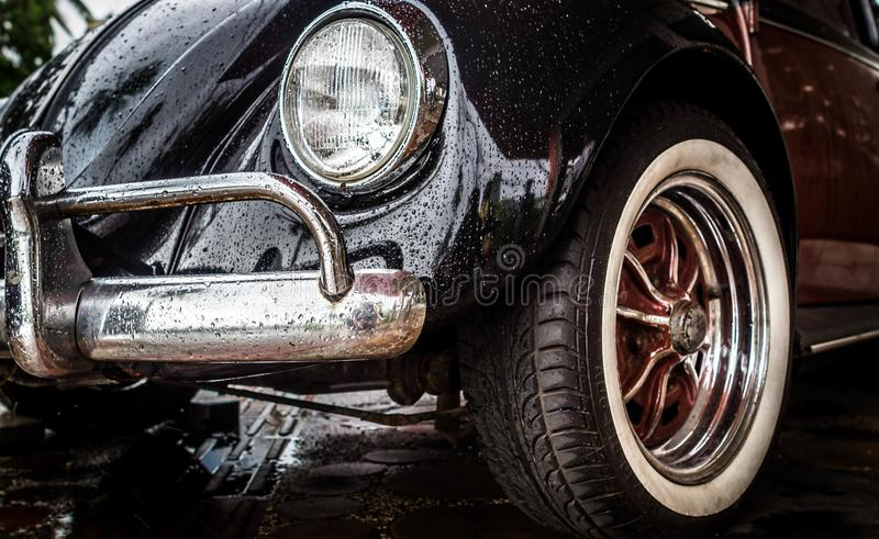 Old VW Volkswagen Beetle. Detail look of Old VW Volkswagen Beetle front side after the rain stock image