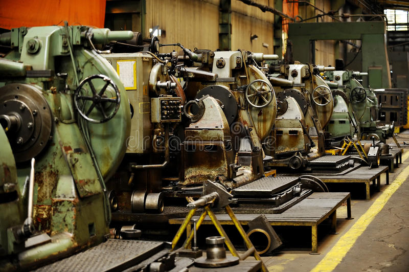 Detail with machinery inside old factory stock image