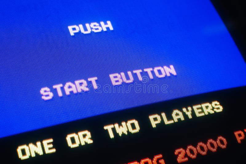 Detail Macro of an old vintage video game with text Push start button. With option to select one or two players royalty free stock photos