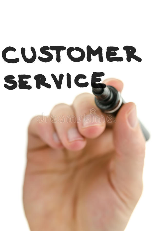 Detail of male hand writing phrase customer service on a virtual stock photography
