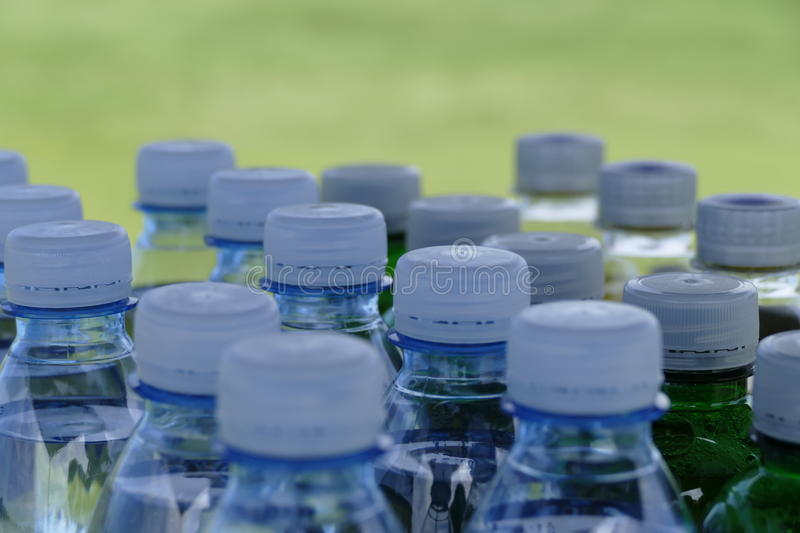 Detail of many plastic bottles with white tops stock images