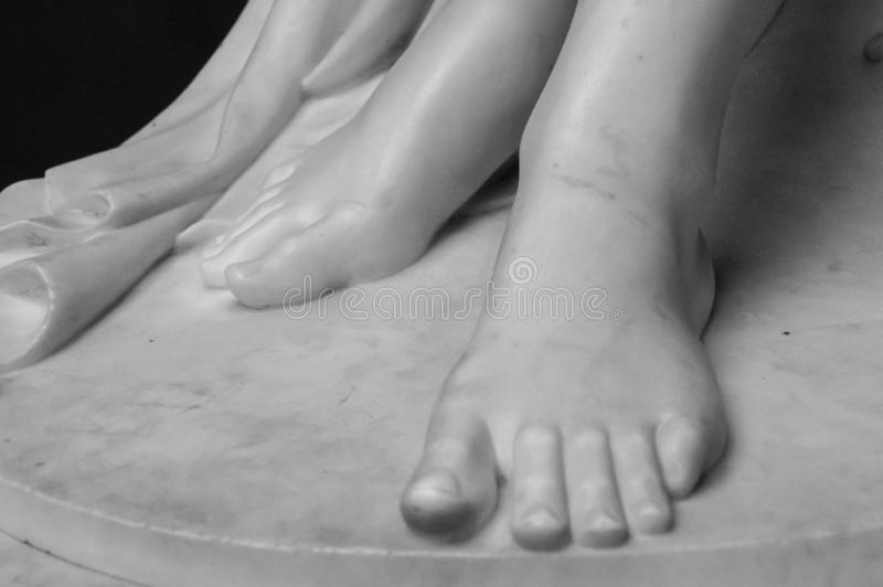Detail of a marble statue, depicting the foot of the suffering Christ stock photo