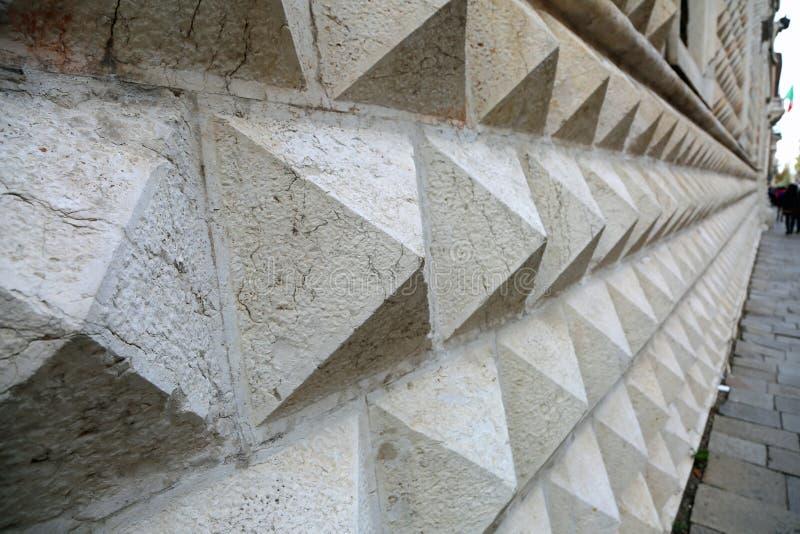 Marble wall of the Palazzo dei Diamanti in Ferrara, Italy. Detail of the marble wall of the Palazzo dei Diamanti in Ferrara, Italy stock images