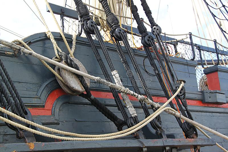 Detail of mast of ship. Detailed rigging with sails. stock photo