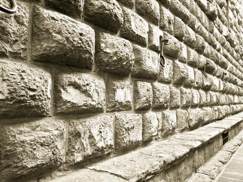 Detail of the Medici Riccardi`s Palace stone wall in Florence. A magnificent example of Renaissance architecture Italy-Tuscany-Florence stock photo