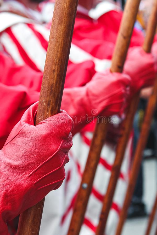 Detail of men hand holding spear. Traditional parade on Swiss National Day. National holiday of Switzerland, set on 1st August. Ce. Lebration of the founding of stock photography
