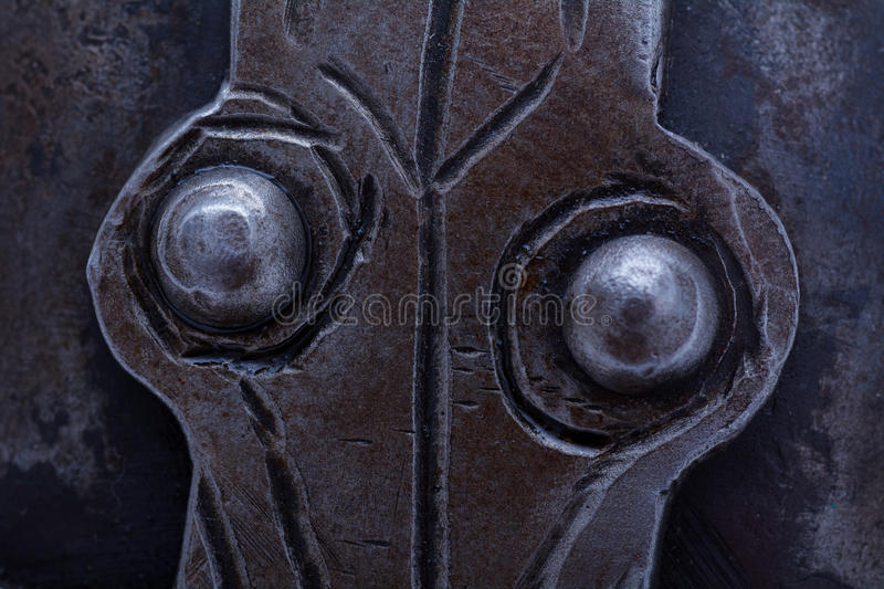 Detail metal rivets. Detail of metal rivets on the viking helmet royalty free stock image