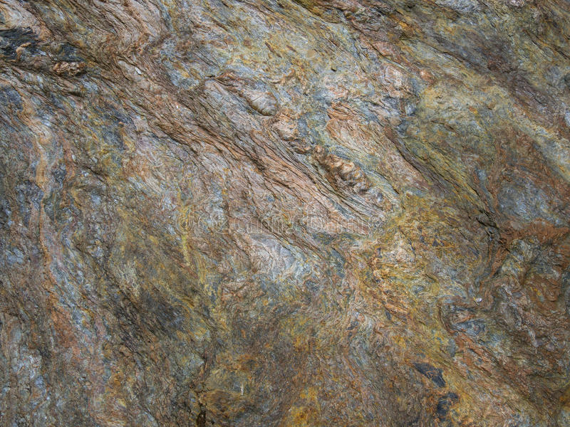 Detail of Metamorphic rocks with colorful mineral streaks. Tex royalty free stock photography