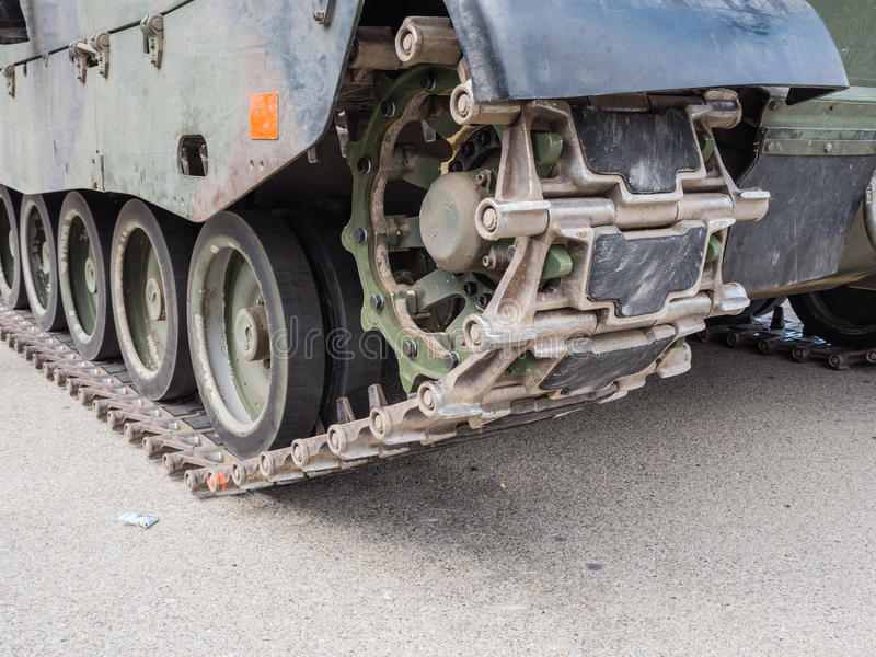 Detail of military tank. ALMERE, NETHERLANDS - 12 APRIL 2014: The wheels and caterpillars of a Dutch military armored fighting vehicle on display during the stock photos