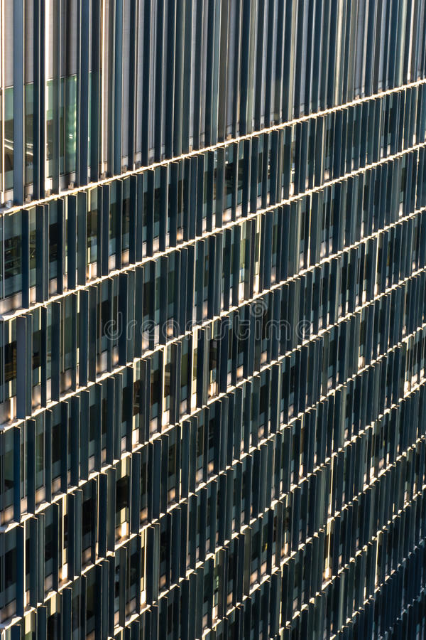 Detail of modern architecture office building facade. Modern architecture office building facade details in late afternoon sunlight stock photos