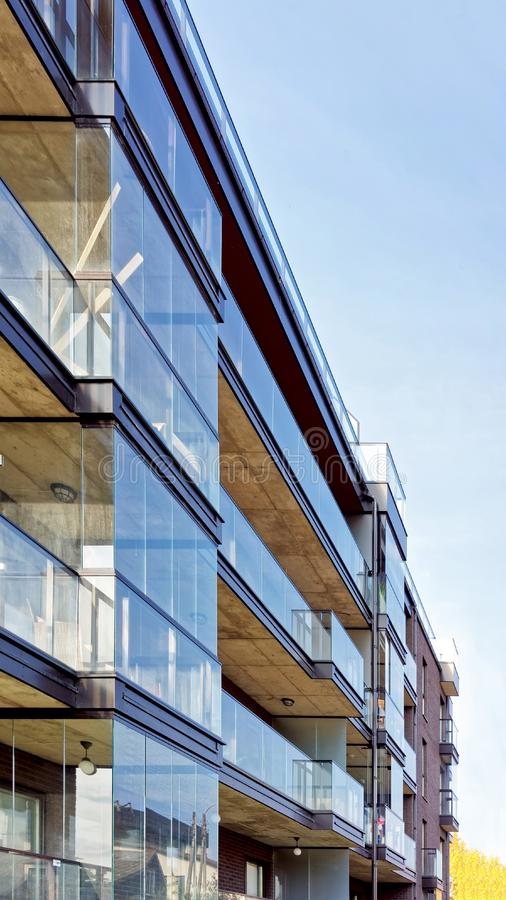 Detail of Modern glass architecture of residential building royalty free stock photo