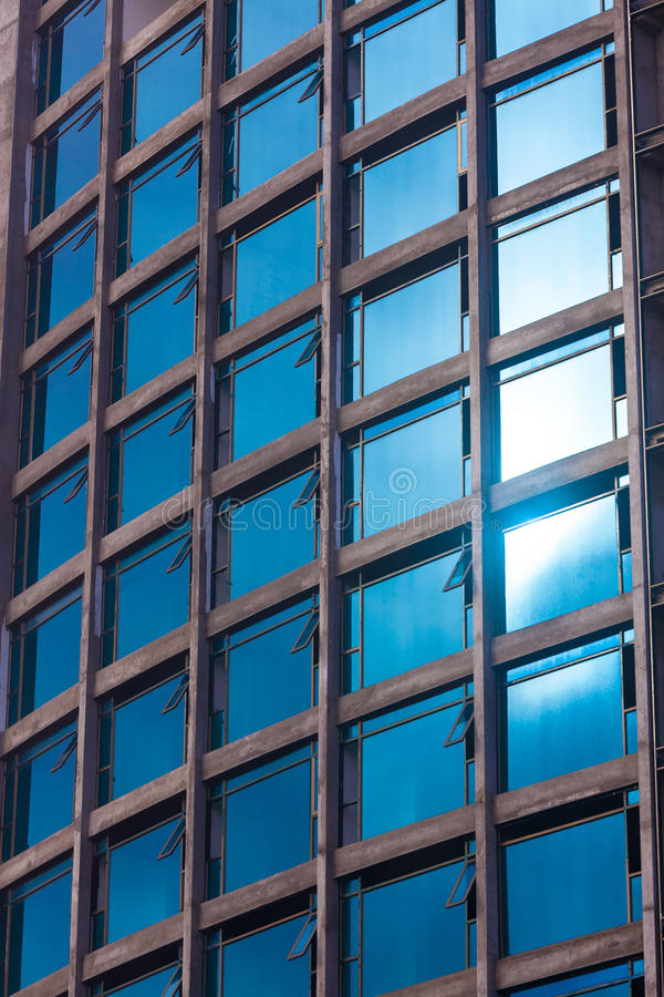 Detail of modern multi-storey hotel with glass facade. And sun glare stock images