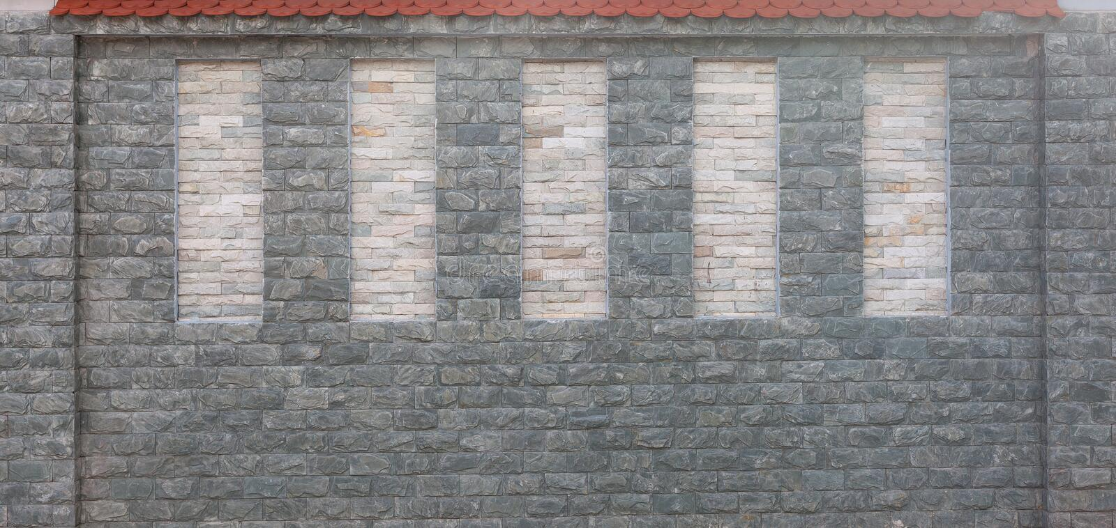 Detail of modern stone wall with red tiled roof. Textural background stock photos