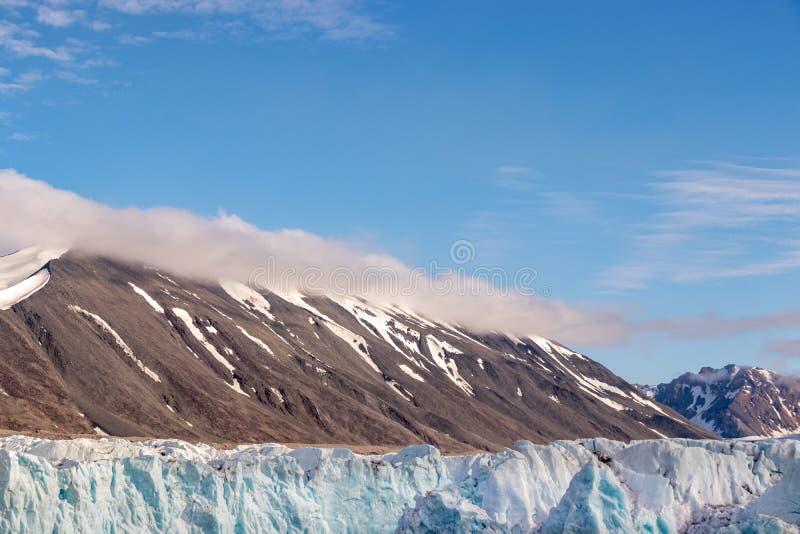 The Monacobreen - Monaco glacier in Liefdefjord, Svalbard, Norway. Detail of the Monacobreen Glacier at Liefdefjord, Svalbard, Norway stock photography
