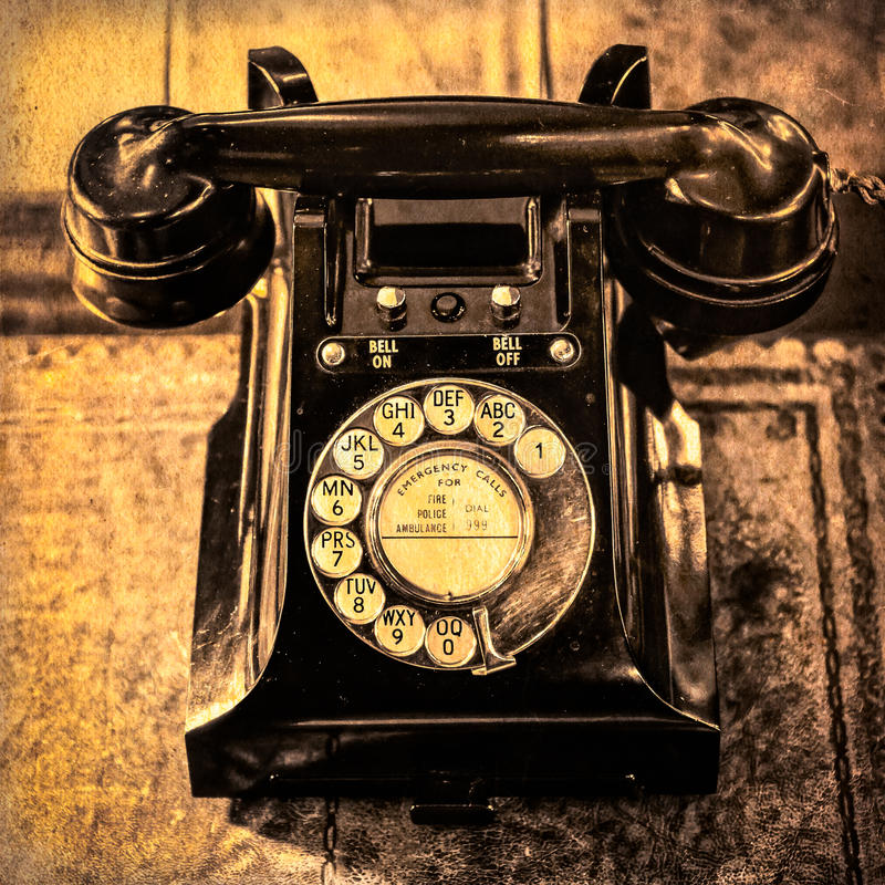 Detail monochrome view of old vintage dial telephone. On the table stock image