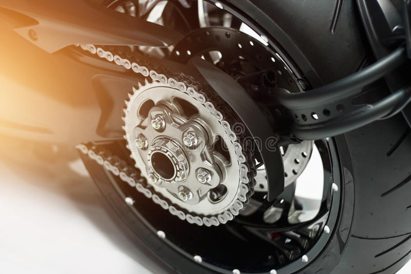 Detail of motorcycle rear chain and gear stock image