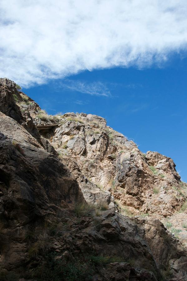 Detail of mountain rocks, part sunny and partly shaded stock photography