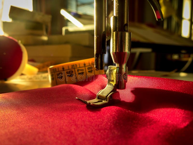 Sewing machine. Sewing workshop. Detail of needle of a sewing machine. Sewing workshop stock photos
