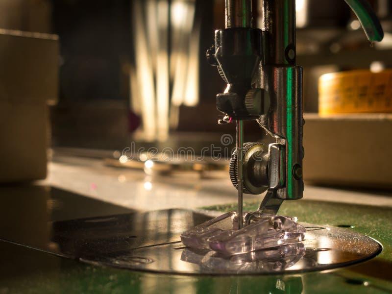 Sewing machine. Sewing workshop. Detail of needle of a sewing machine. Sewing workshop stock photo