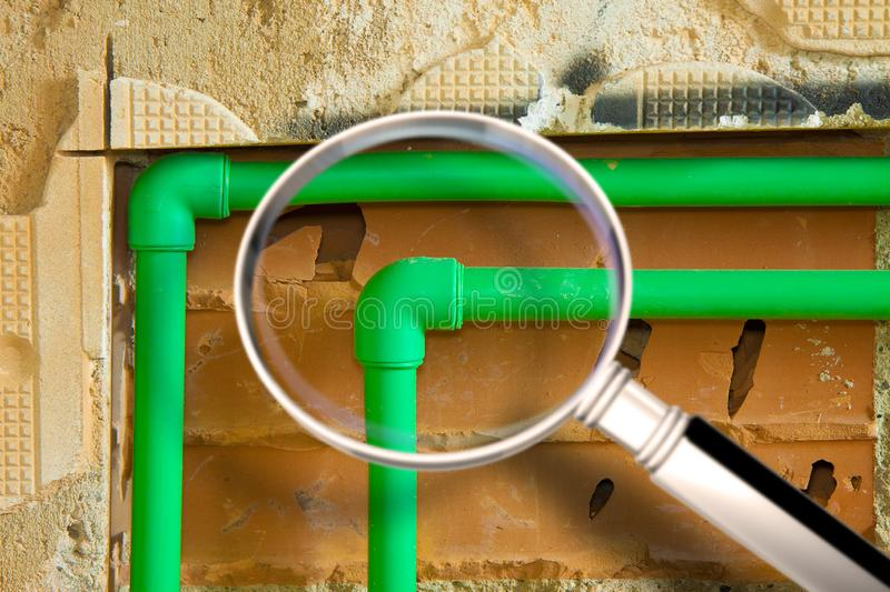 Detail of a new hydraulic system with a green polypropylene pipes for hot and cold water in an italian construction site - concept. Image seen through a royalty free stock images