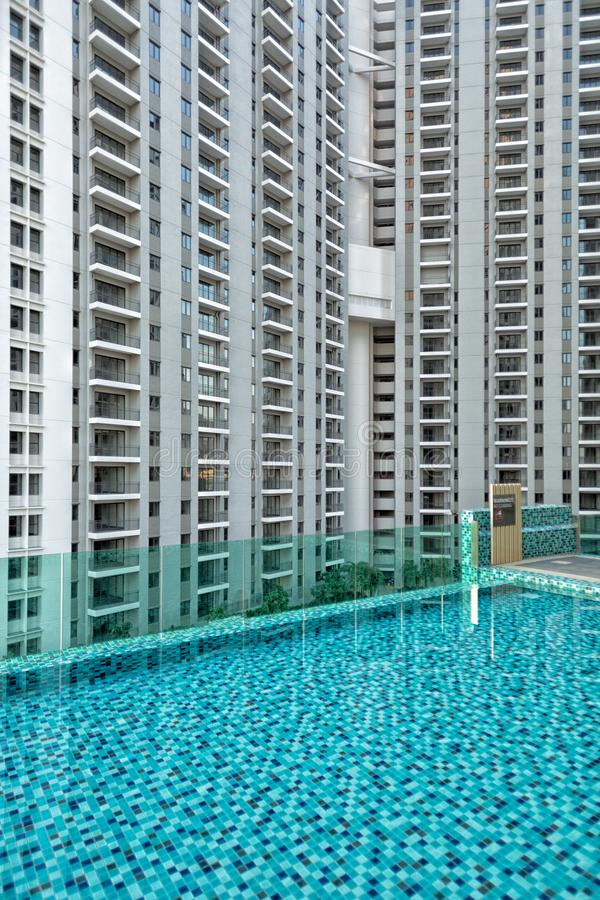 Detail of new residential apartment block, not yet occupied, with swimming pool in foreground. In George Town on Penang Island, Malaysia stock images