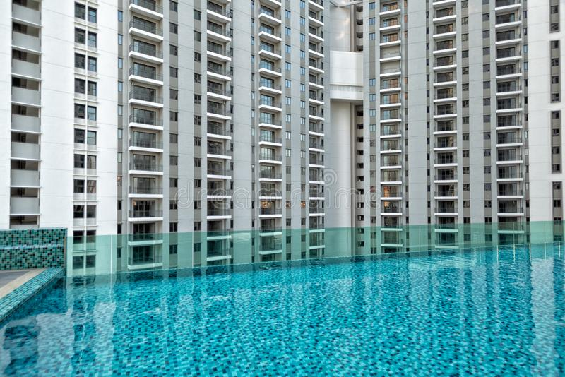 Detail of new residential apartment block, not yet occupied, with swimming pool in foreground. In George Town on Penang Island, Malaysia royalty free stock photos