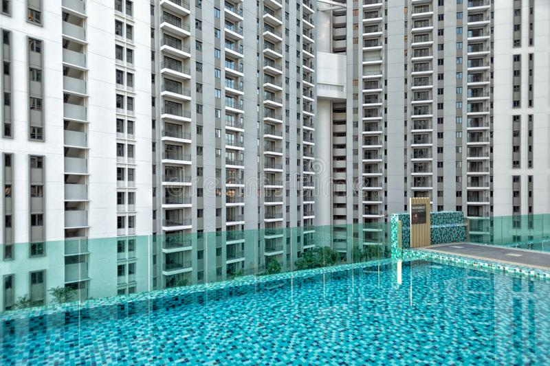 Detail of new residential apartment block, not yet occupied, with swimming pool in foreground. In George Town on Penang Island, Malaysia stock photo