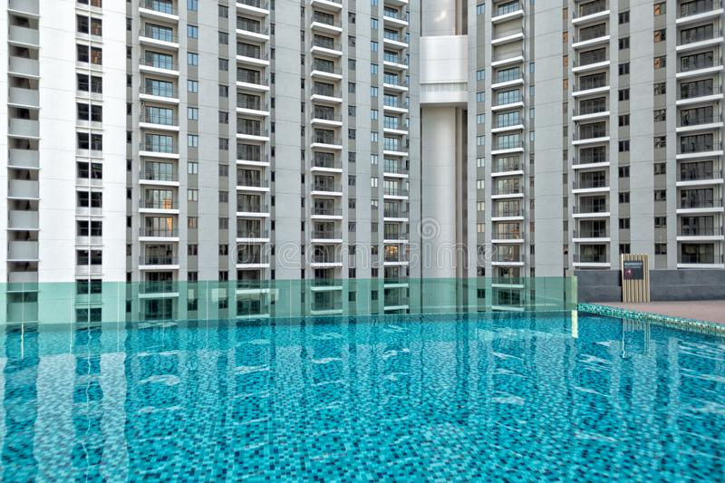 Detail of new residential apartment block, not yet occupied, with swimming pool in foreground. In George Town on Penang Island, Malaysia royalty free stock photo